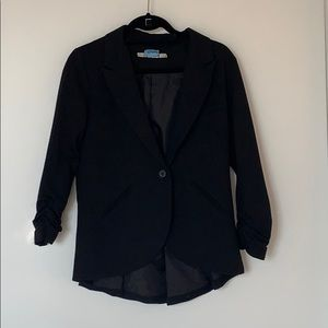Black blazer with fun detail on sleeves and back